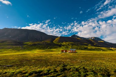 Wallpaper norway landscape nature of the mountains of Spitsbergen Longyearbyen Svalbard building city on a polar day with arctic summer in the sunset and blue sky with clouds