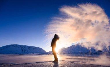 boiling water frost in polar arctic  sky  in Norway Svalbard in Longyearbyen  man mountains