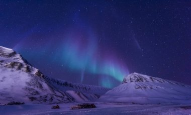 The polar arctic Northern lights aurora borealis sky star in Norway Svalbard in Longyearbyen city man mountains