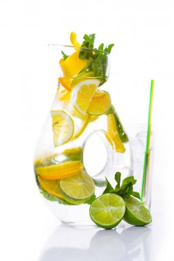 A fresh cocktail of tropical fruit and juice with ice. Fresh fruit lime, lemon, mint, kiwi. Top view. On a white background.