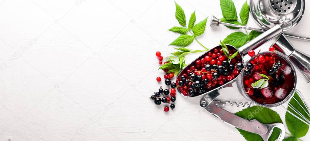 Cocktail of fresh red currant with ice, on a wooden background. Top view. Free space. stock vector