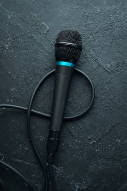 Microphone on black stone table. Studio. Top view. Free space for text. Copy space.