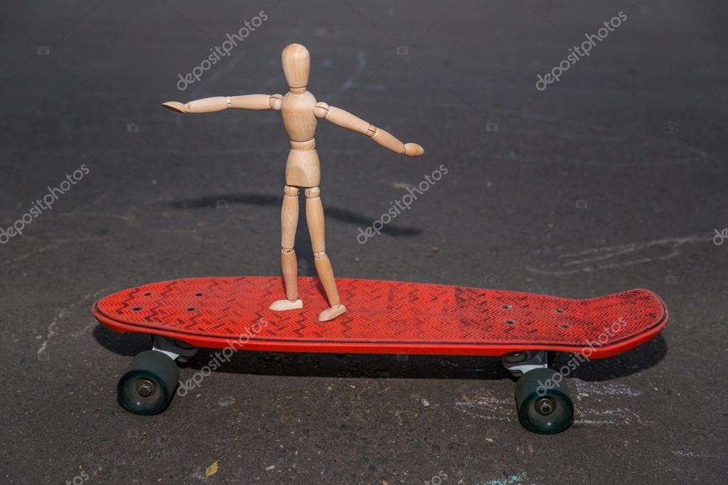 The Wooden Little Man Rides A Penny Board Stock Photo Twins03