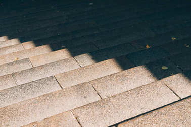 Urban stone stairs in the sunlight