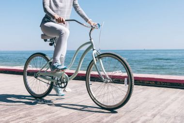 Young woman rides on bicycle