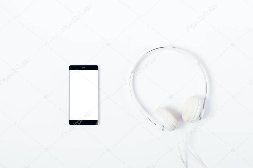 Mobile phone with blank screen and headphones