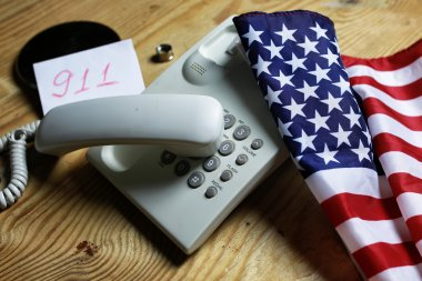 telephone domestic on wooden background concept of 911 emergency