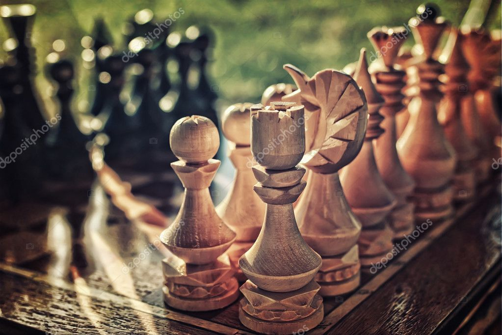 textured retro effect photo of chess on board concept