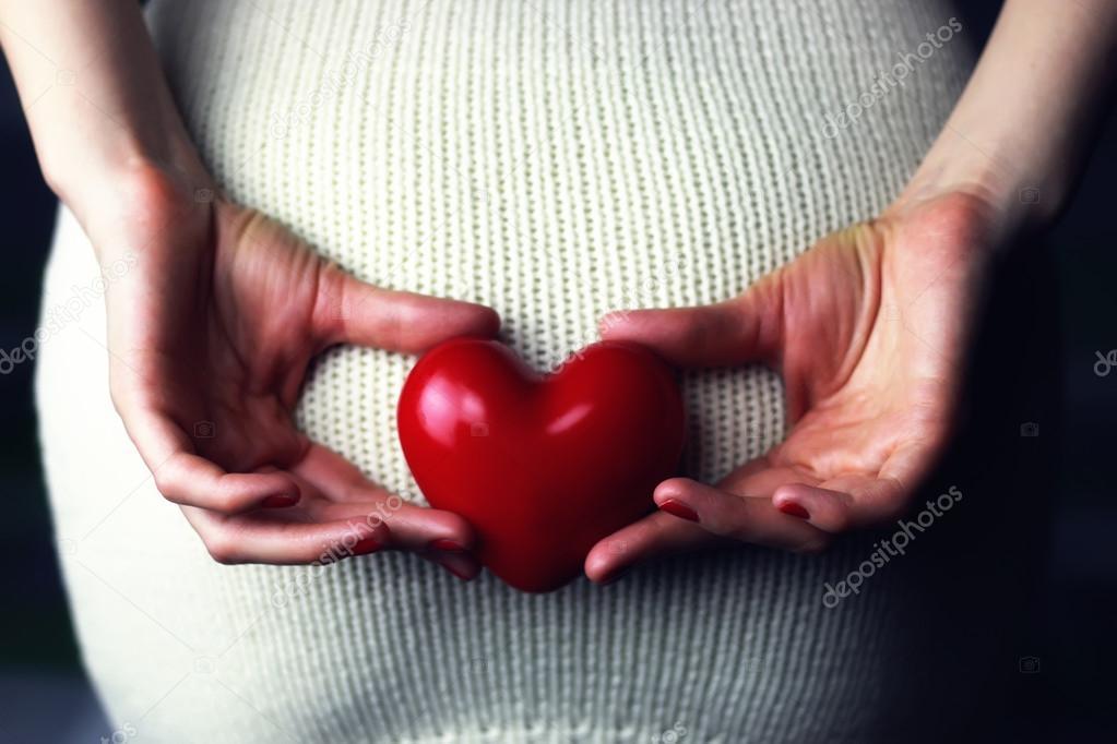 Woman holding heart — Stock Photo © alexkich #128718270