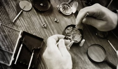 black and white photo watch clock repairing
