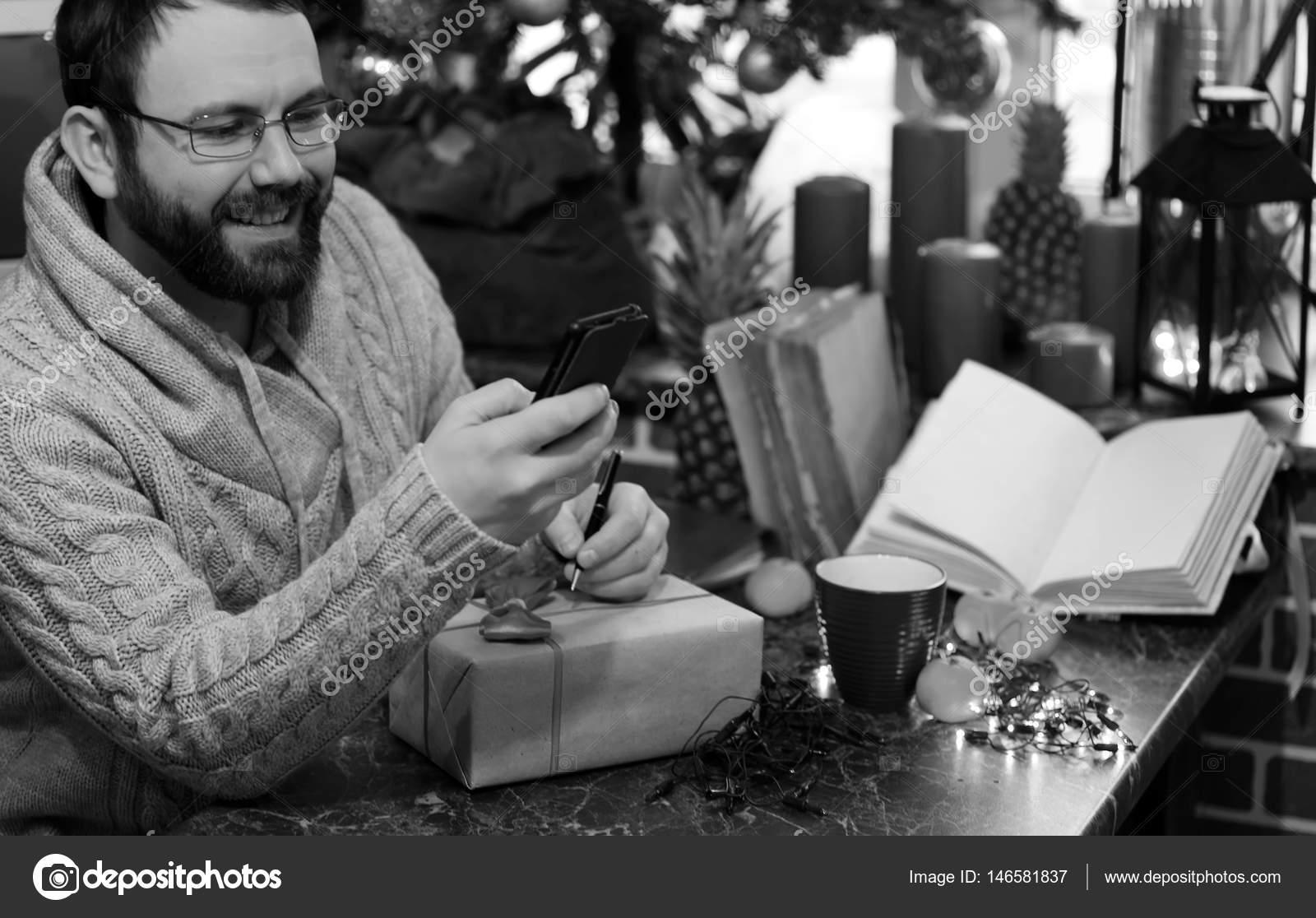monochrome beard man writing christmas gifts on a table — Stock ...