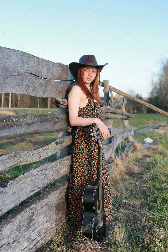 cowgirl un hat with guitar