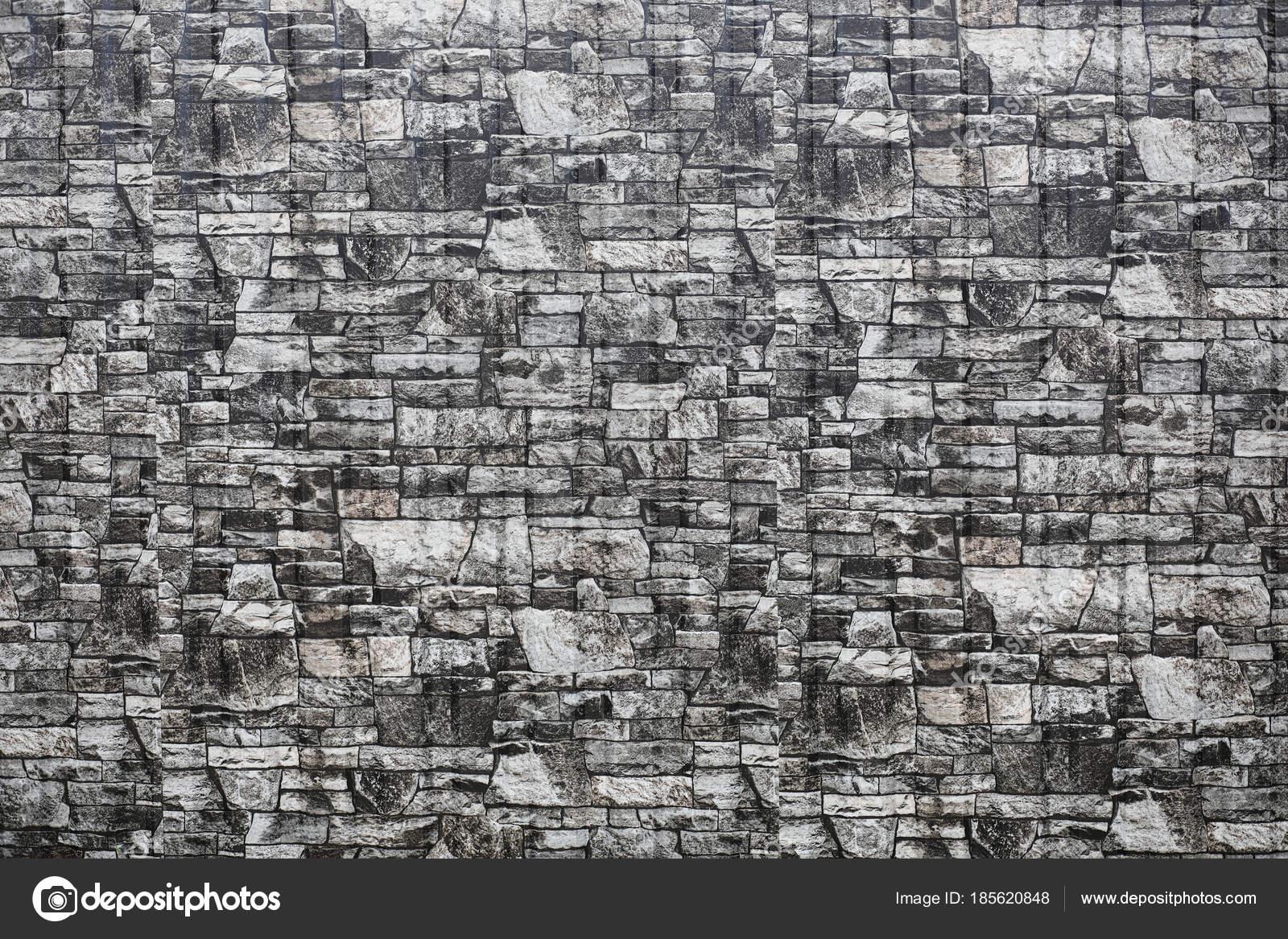 La texture delle pietre. piastrelle in pietra martellata. reticolo