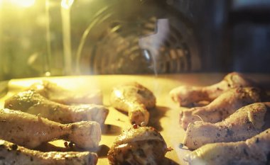 Baked chicken in the oven. Turkey legs on a baking sheet with spices baked in the oven. Snack Thanksgiving Day.