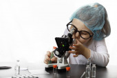 Young scientists chemists. Childrens vocational guidance. Choice of profession. Doctor, laboratory assistant, chemist.