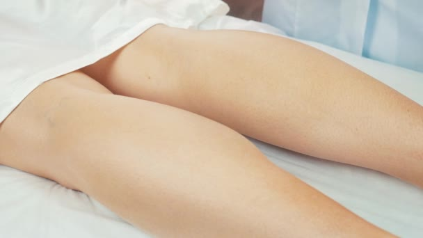 Extra close-up of oiling womans leg after depilation