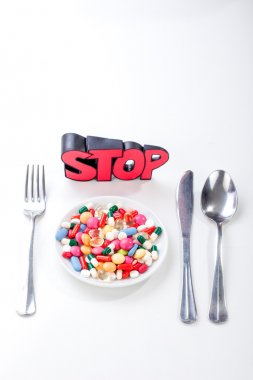 Drugs, medicine on a dish with fork, spoon