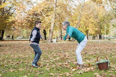 Boy running to grandmother