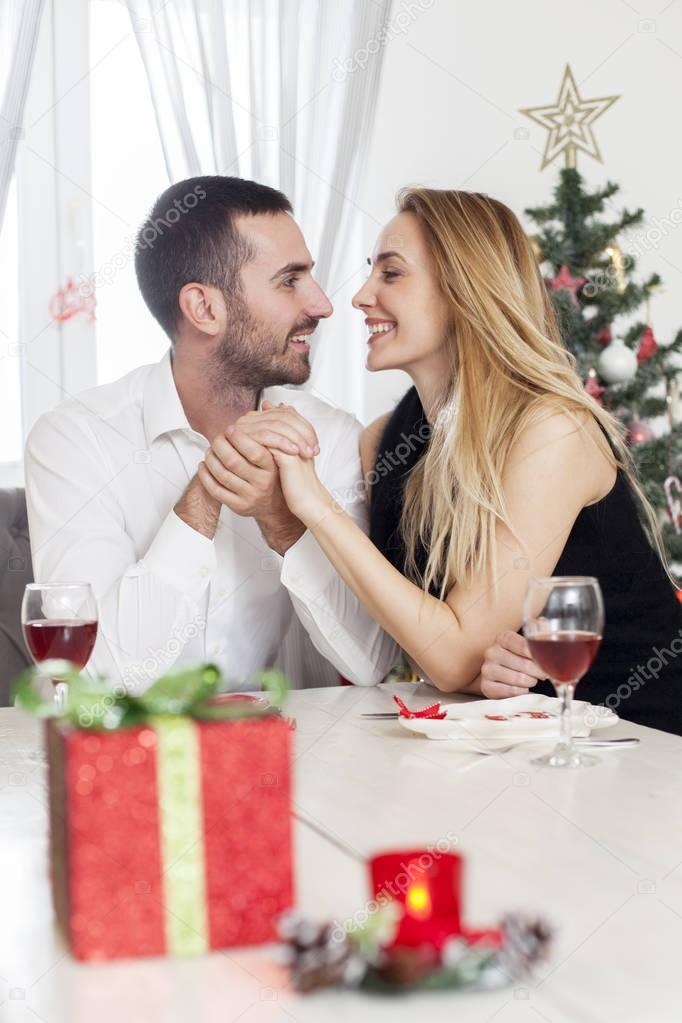 Couple in love at Christmas dinner