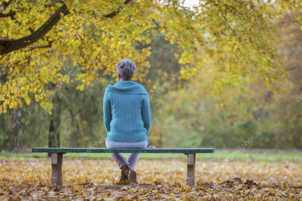 Middle aged woman in the autumn park