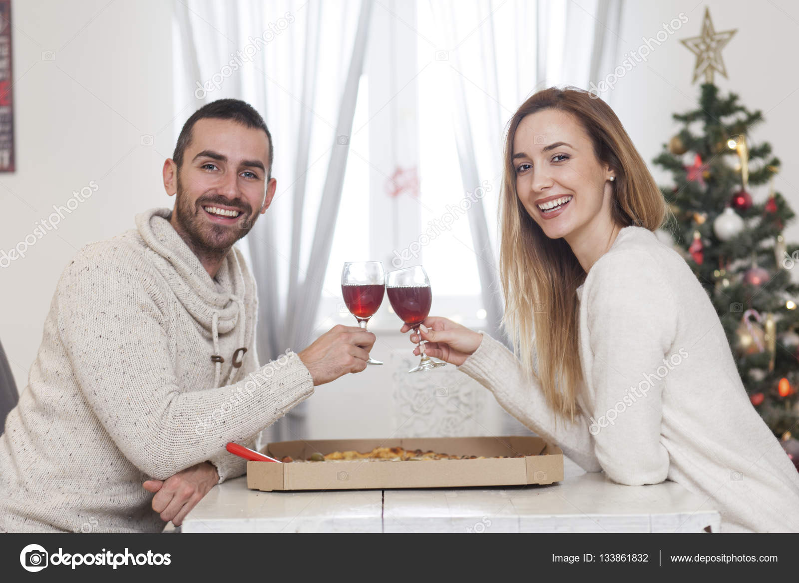 couple sharing a pizza for New Years eve — Stock Photo © Nikodash ...
