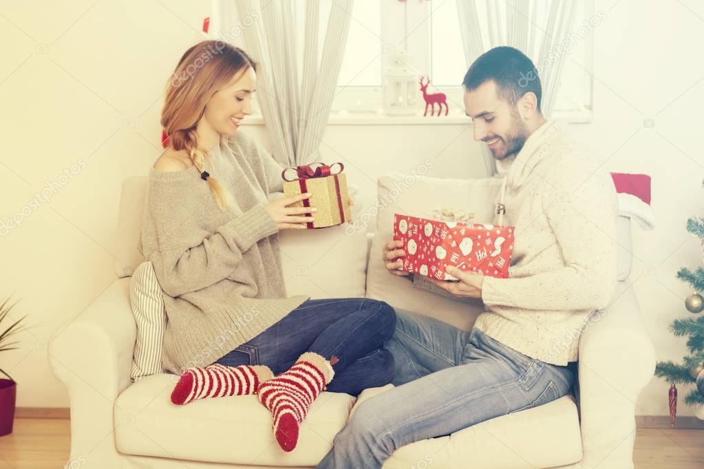 Couple in love with Christmas presents