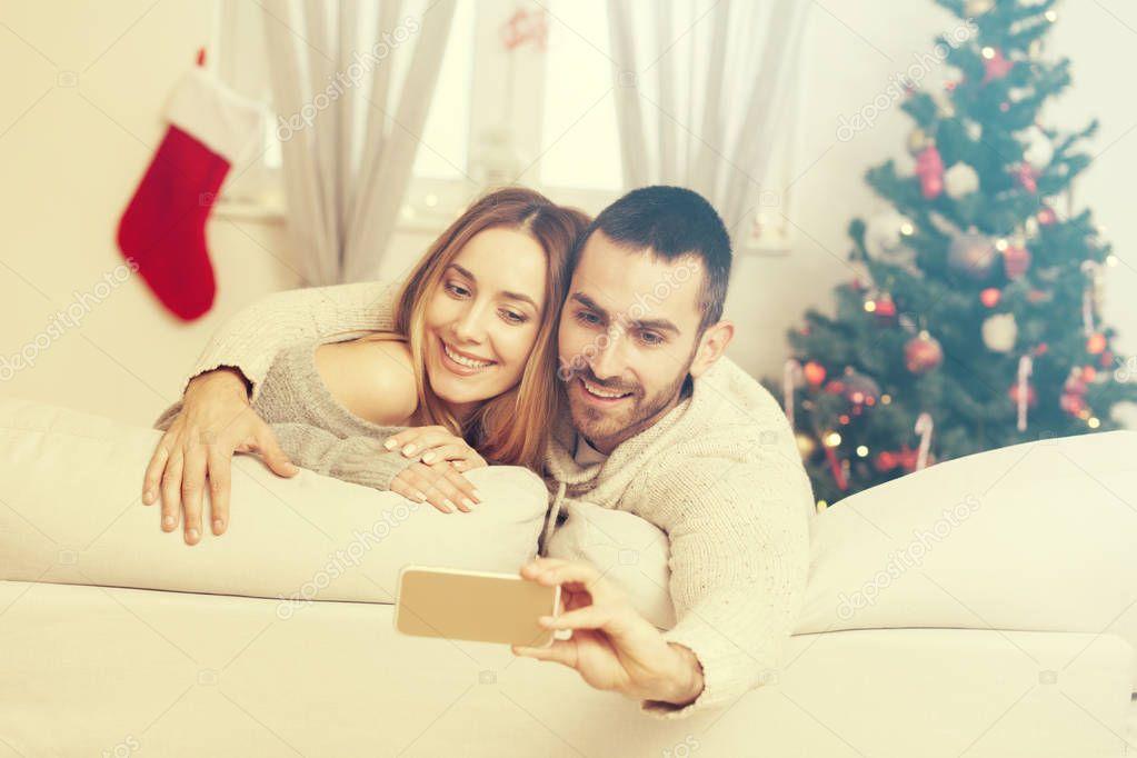 couple taking selfie on Christmas night