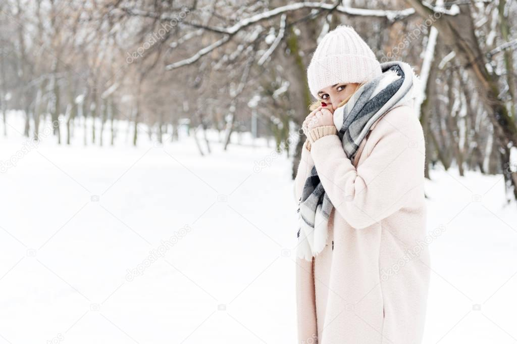 Young woman in a park full of snow