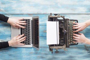 Old typewriter and laptop