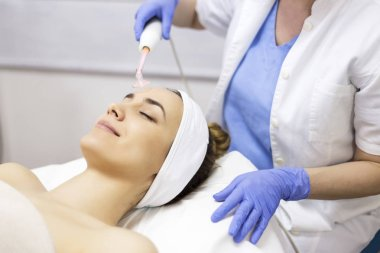 woman receiving facial beauty treatment