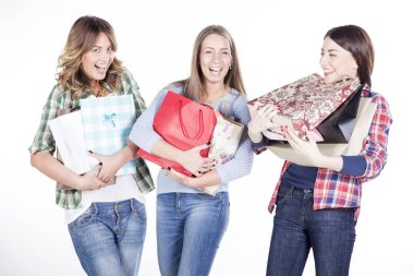 happy women smiling with shopping bags
