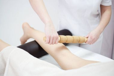 Anti cellulite massage for woman with rolling pins
