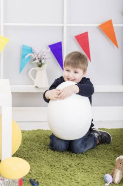 Baby boy playing on Easter day