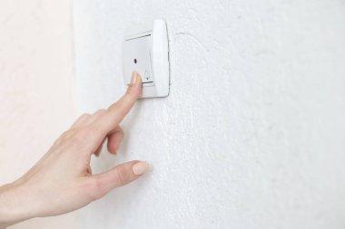 Woman pressing doorbell