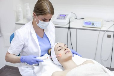 Woman getting facial laser treatment