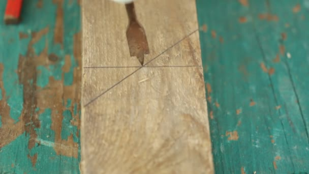 Cropped image of carpenters hands using drill on wood at construction site
