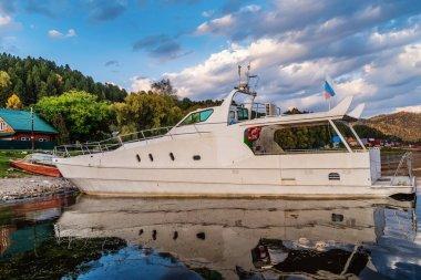Pleasure boat moored to the shore. Russia, the Republic of Altai, Turochaksky District, village Artybash
