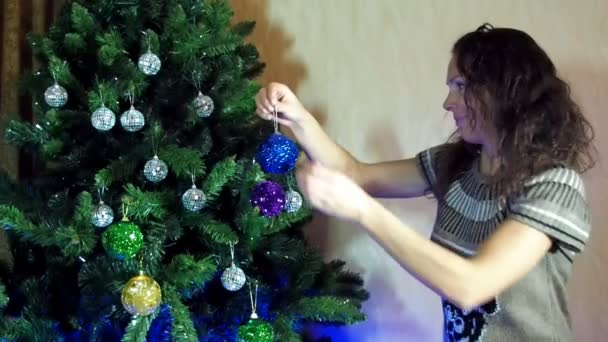 new year, christmas woman decorates a Christmas tree