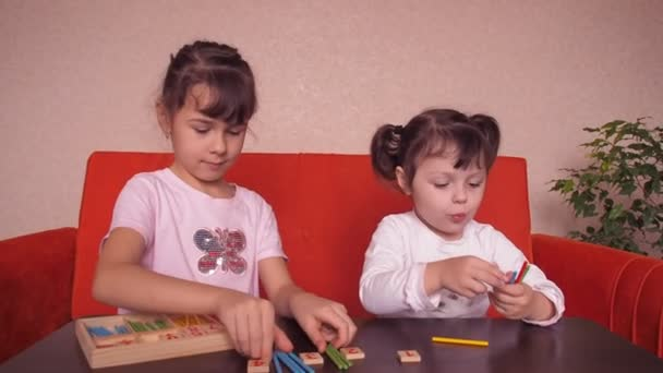 Girls play with educational toys