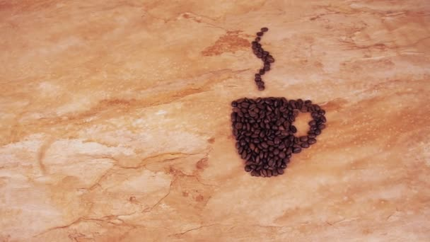 A cup of coffee beans. On the kitchen marble table a sign of a cup of coffee beans.