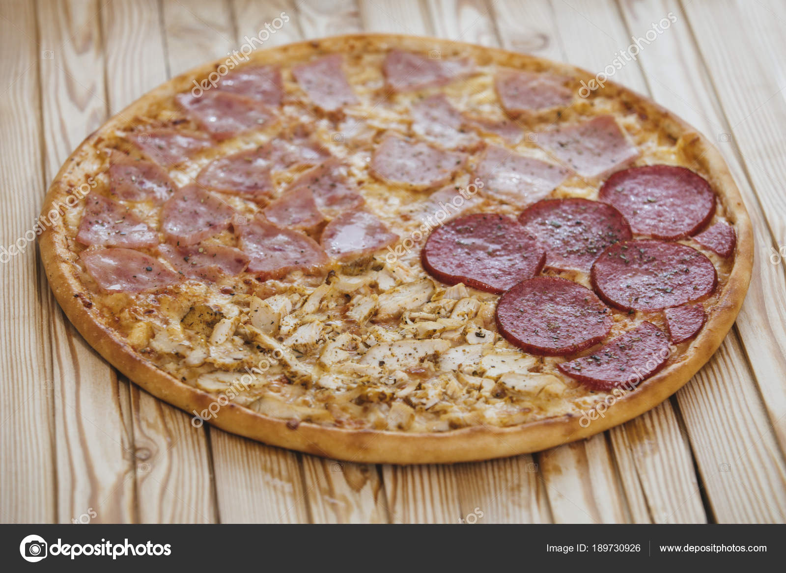 Italian Pizza With Four Types Of Meat On A Wooden Table Tasty An U2014 Stock  Photo
