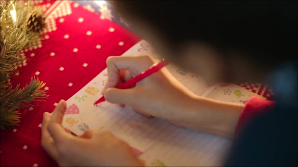 black girl writing a letter to santa claus on christmas eve