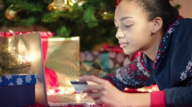 close up hands writing christmas letter to santa claus on