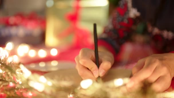 A girl is writing a letter to Santa Claus in New Years Eve