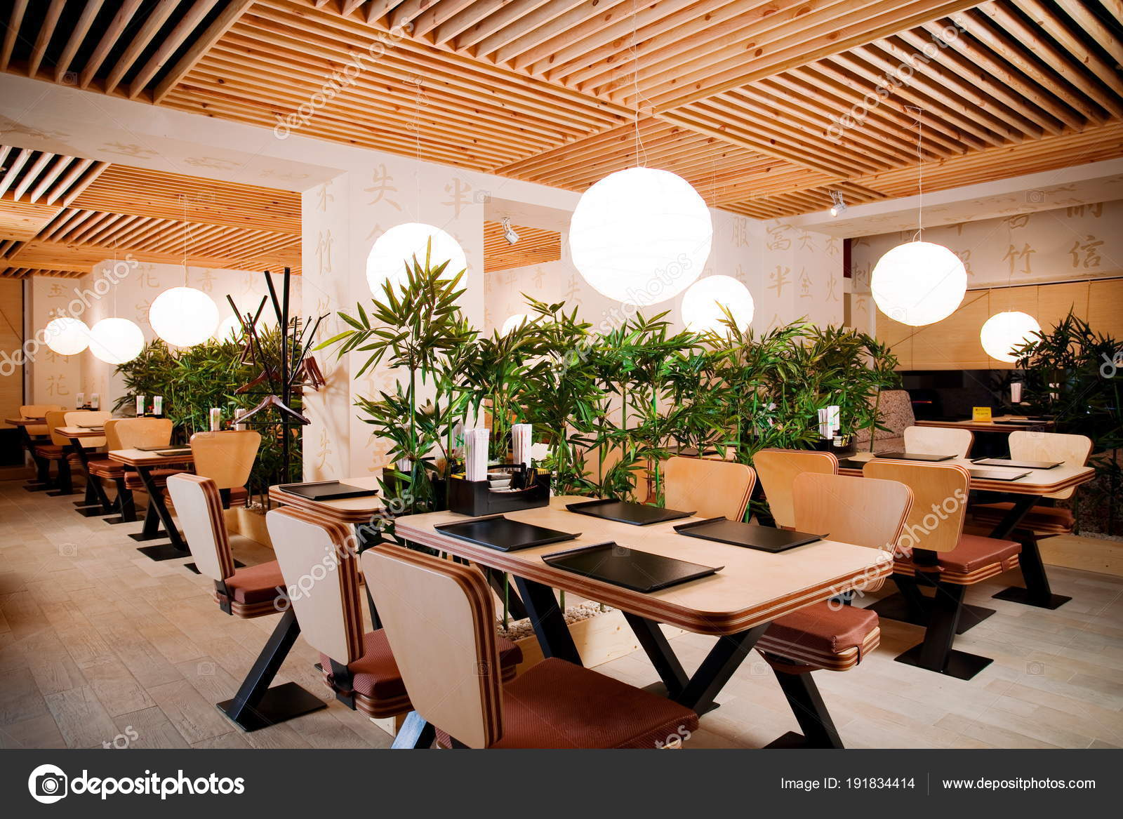 asian restaurant interior with wooden ceiling and walls and green
