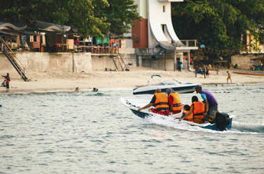 PANGKOR ISLAND, MALAYSIA - 17 DECEMBER 2017 : tourist enjoying beach activities and return from island hoping by boat