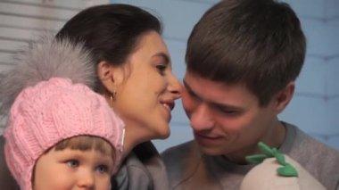 Mom kisses dad, father kisses his son