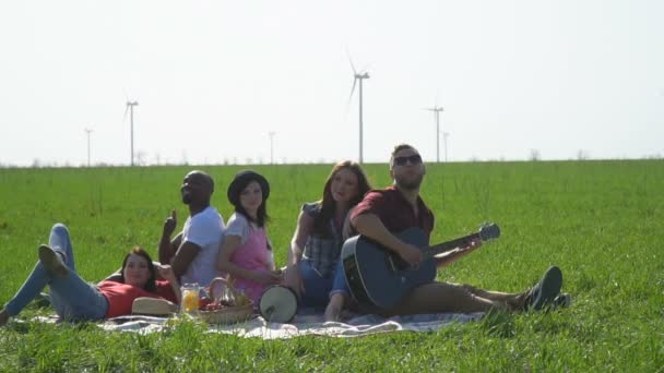 Group of people on a picnic showing thumb up, slow motion