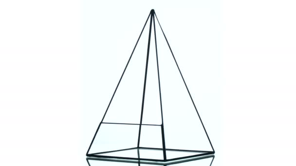 Glass florarium in the form of a pyramid
