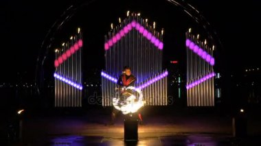 A guy with a fireball on the background of a burning organ
